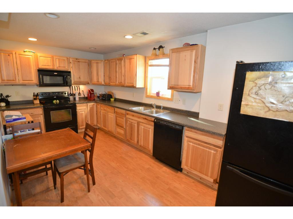 Fully applianced kitchen with hickory cabinets.