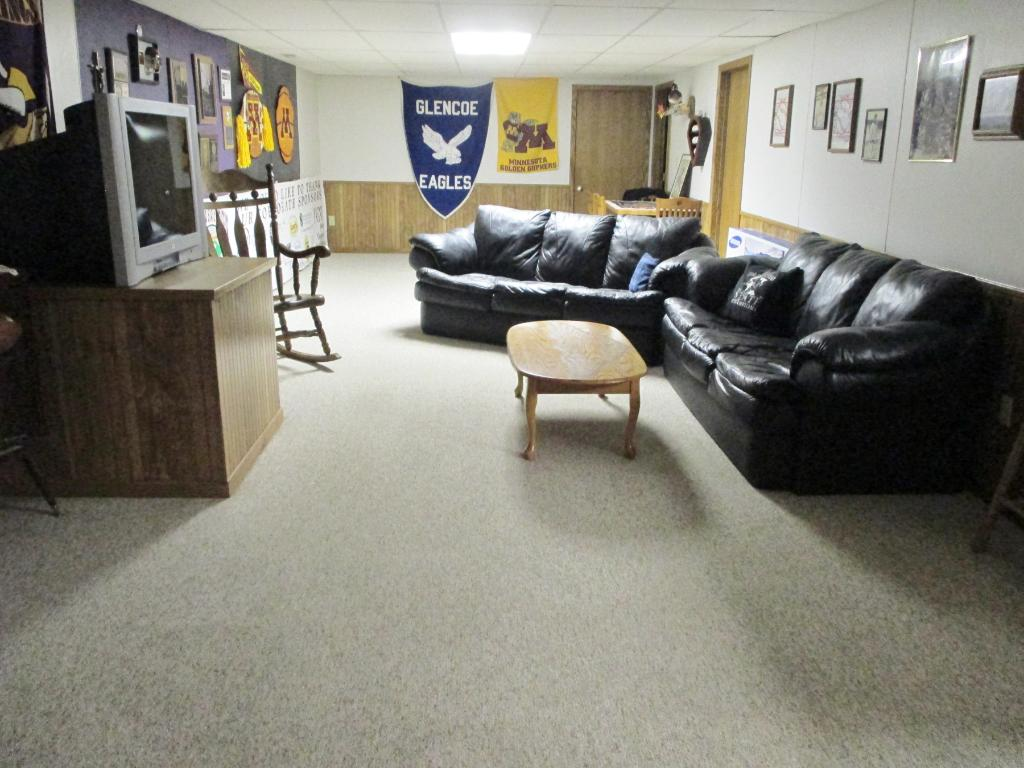Spacious Lower Level Family Room with Bar area.