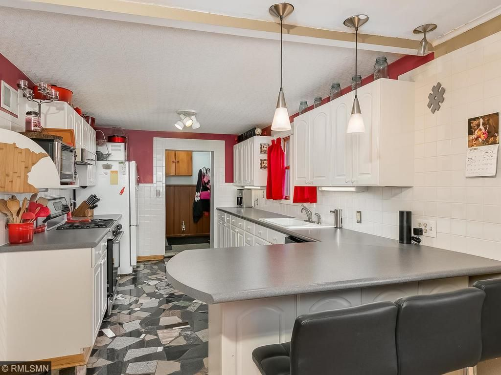 Open, artistic kitchen with additional seating!