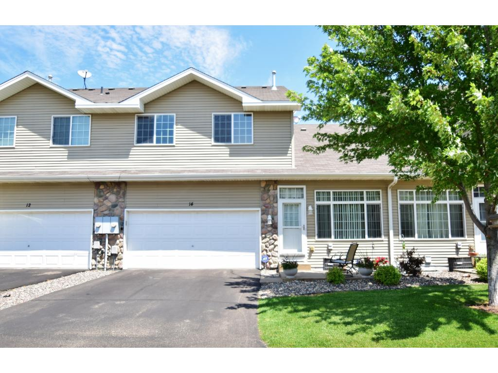Welcome home to 5410 144th Way NW, #14! This home has fantastic curb appeal & features a 2-car garage.