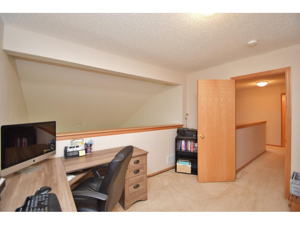 Loft area on upper level is great for home office or play area. Completed with door for privacy, overlooks main level.