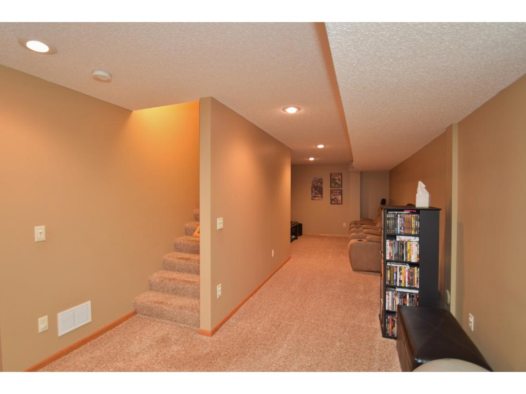 Lower level fully finished with 3rd bedroom and additional living space! Utility room on this level as well.