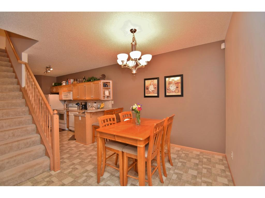 Dining is just steps away from the kitchen. Stairs to the left lead to the upper level with 2 bedrooms, bathroom, laundry and loft/office space.