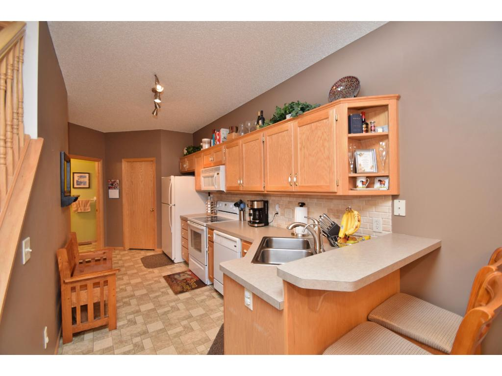 Kitchen features a breakfast bar & walk-in pantry.