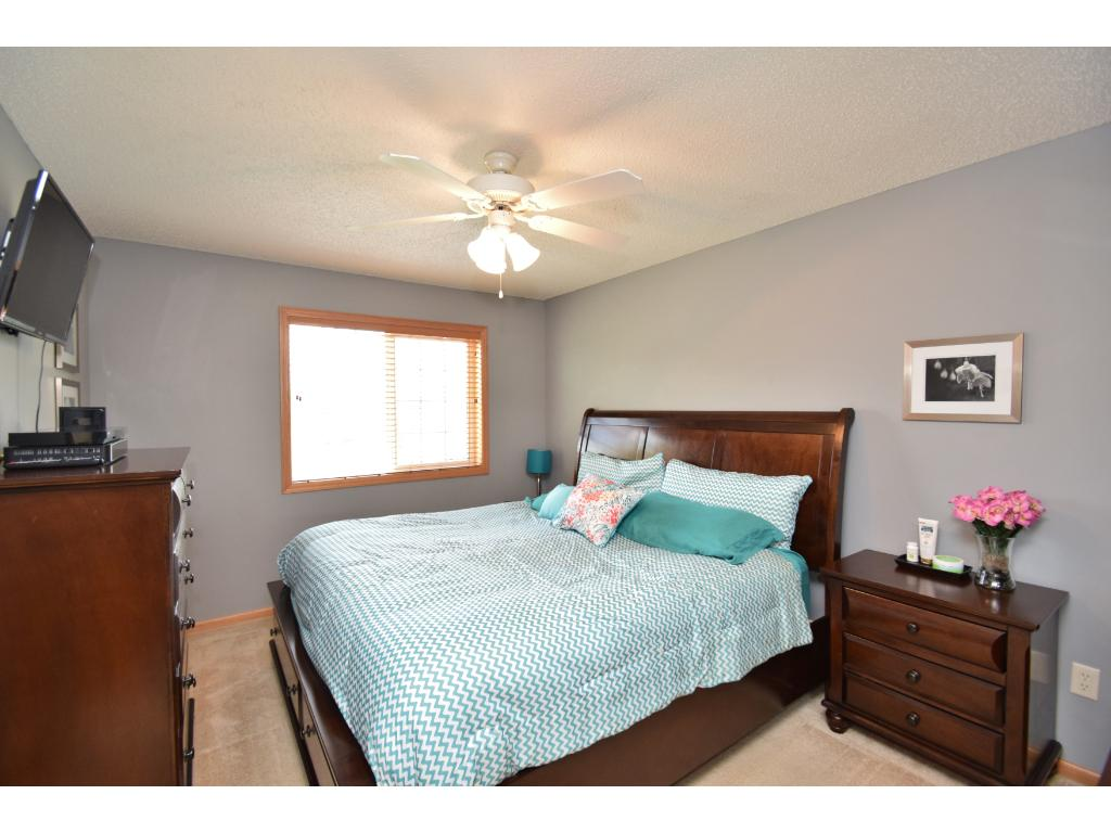 1 of 2 bedrooms on upper level. Master bedroom measures 14x11 and features a walk-in closet which also is connected to the master walk-thru full bathroom. Bathroom has separate whirlpool tub & shower.