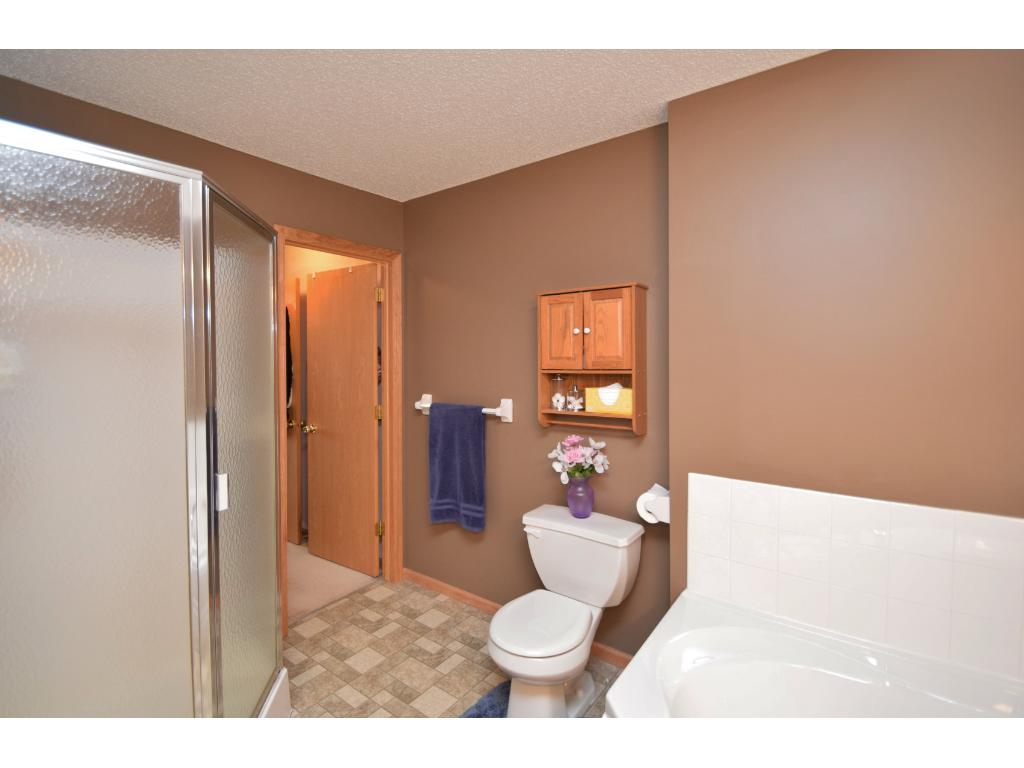 Master-walk thru bathroom on upper level. Separate whirlpool tub and shower. To the left is walk-in closet of master bedroom.
