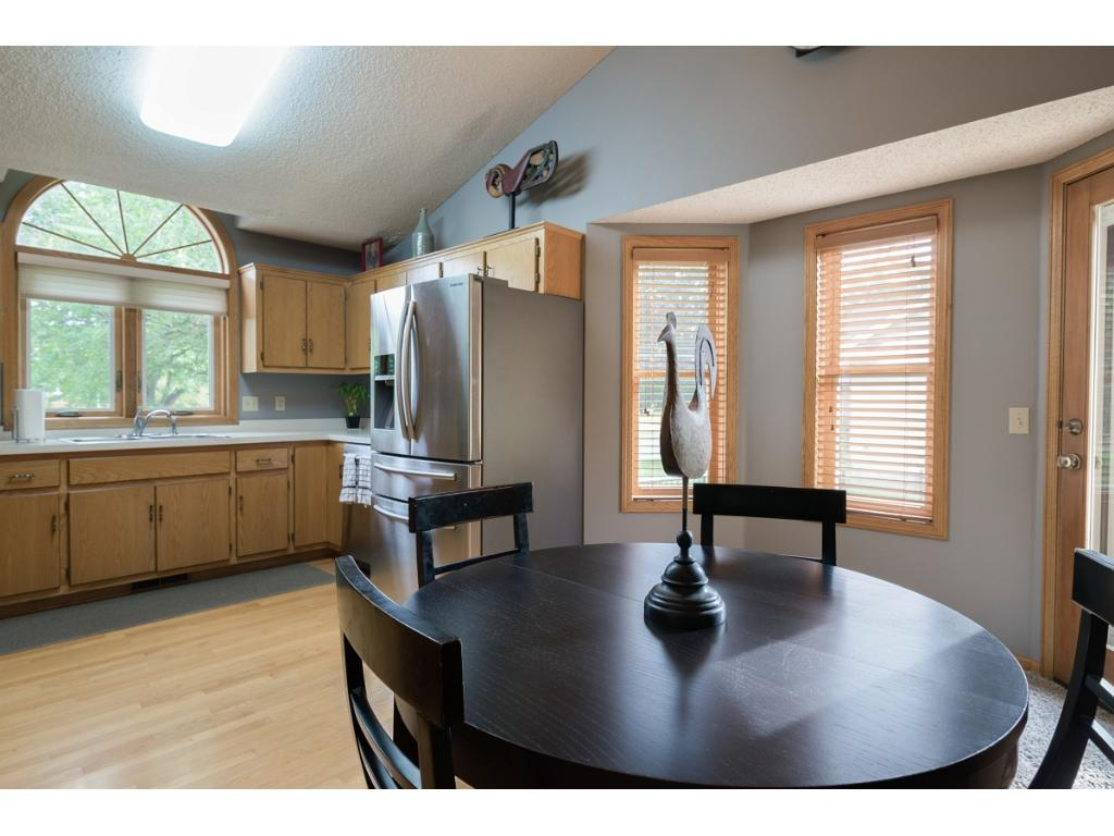 Large kitchen/dining area with walk-out to deck.