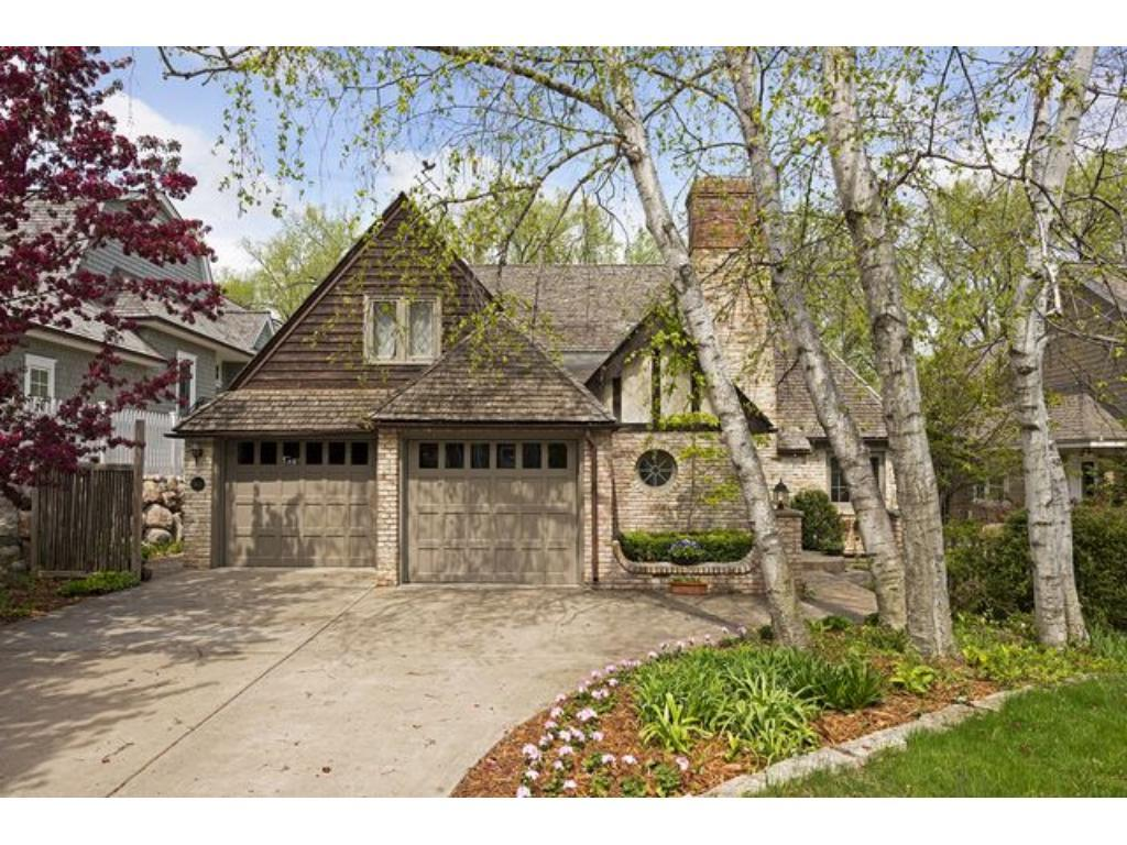 Charming brick English cottage on Minnehaha Creek, just blocks from Arden Park and 50th & France. Private creek views from all levels!