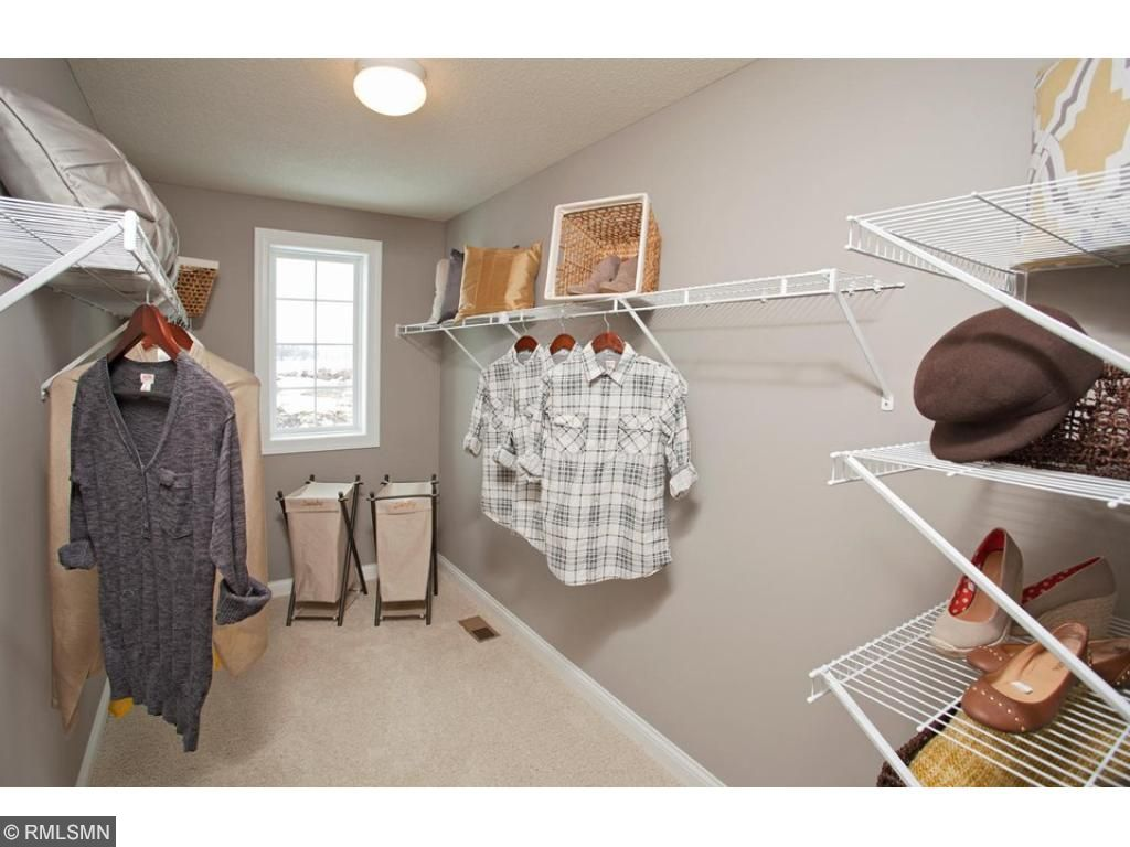 Owners Walk In Closet in Bathroom