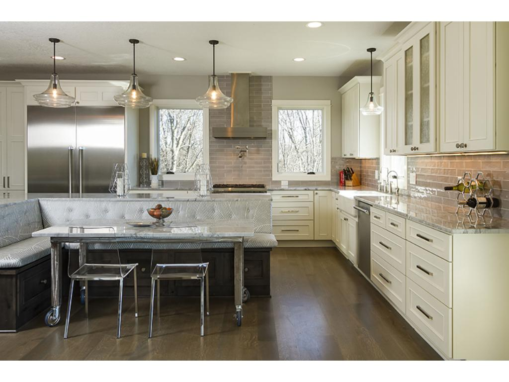 Beautifully designed gourmet kitchen with white cabinets galore!