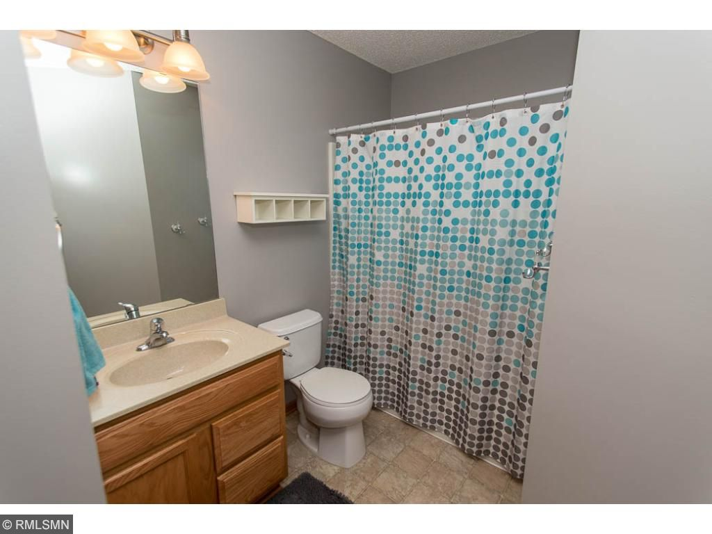Upper level full bathroom with large linen closet.