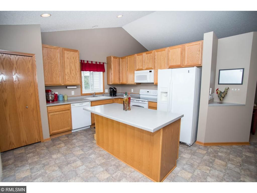 Kitchen has a large center island, pantry, and lots of storage.