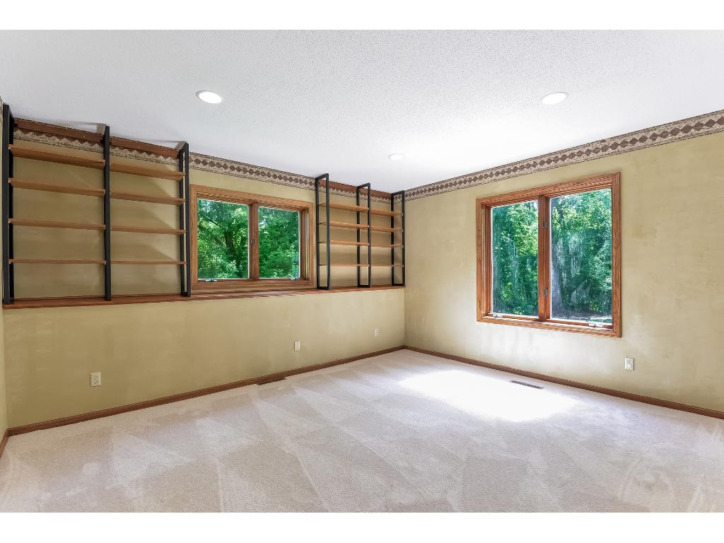 Great space for an office in the lower level with tons of daylight and built ins.