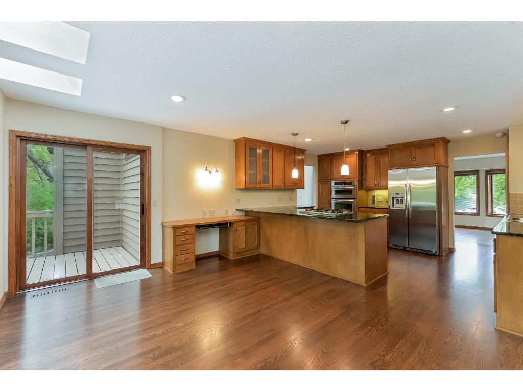 Updated kitchen with granite countertops and stainless steel appliances.