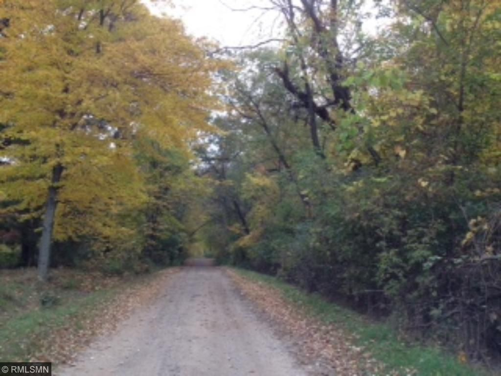 Private road with only 4 houses  which goes back to Chain Lake.Peaceful canopy to drive down to you entry.