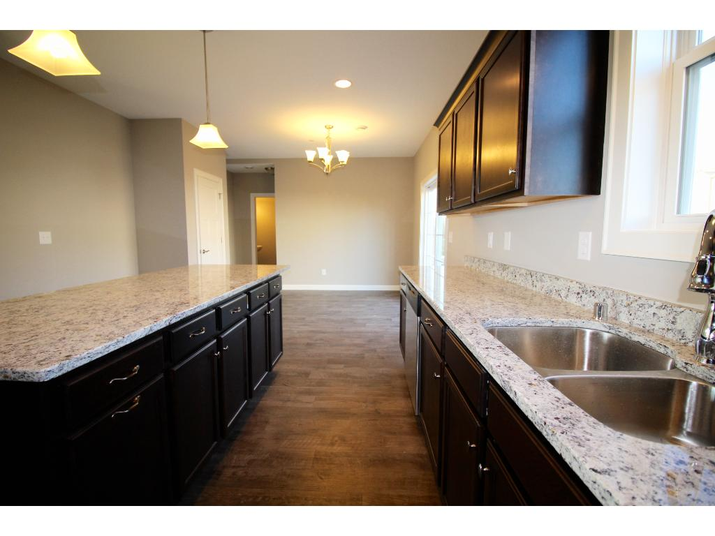 Extra deep stainless steel sink, pull out garbage and recycling on island!