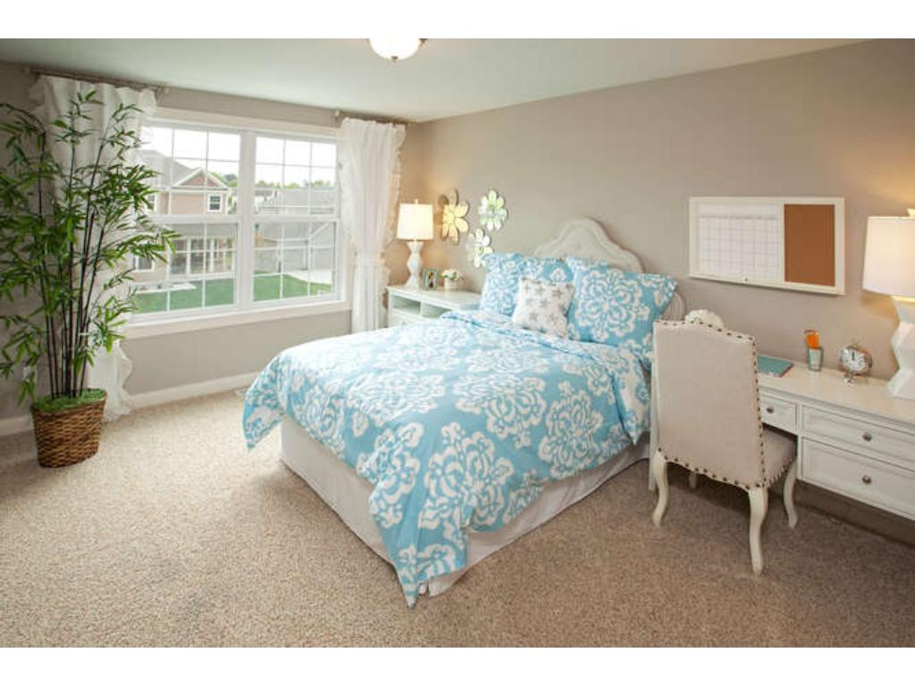 Photos of a Riverton Model (same floor plan, but finishes and options may vary) - Bedroom 2