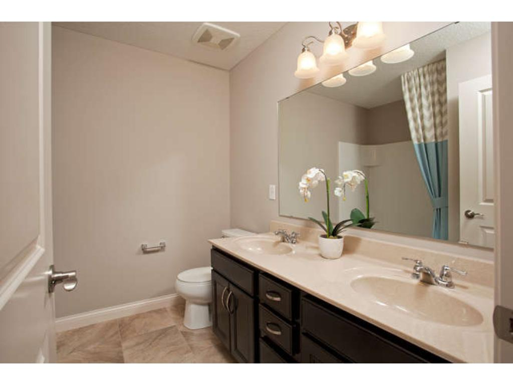 Photos of a Riverton Model (same floor plan, but finishes and options may vary) - Secondary Bathroom with Jack and Jill option
