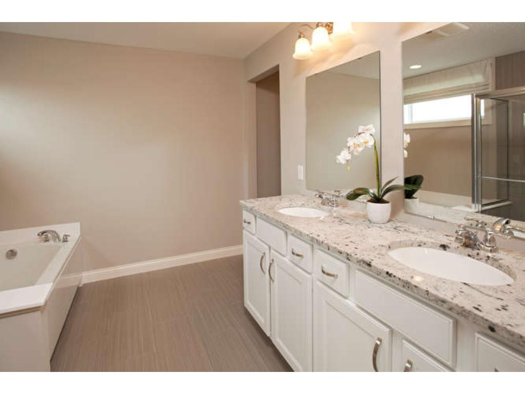 Photos of a Riverton Model (same floor plan, but finishes and options may vary) - Spa Style Owner's Bathroom