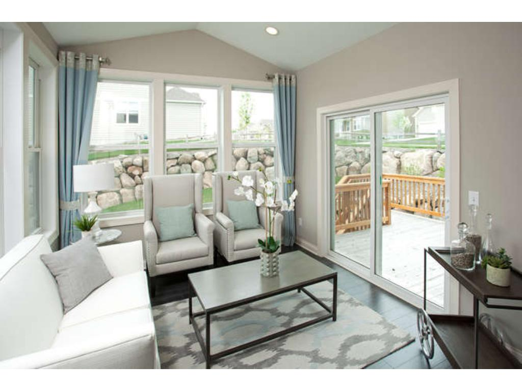 Photos of a Riverton Model (same floor plan, but finishes and options may vary) - Inviting Sunroom