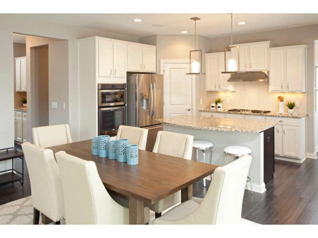 Photos of a Riverton Model (same floor plan, but finishes and options may vary) - Kitchen and Caf area