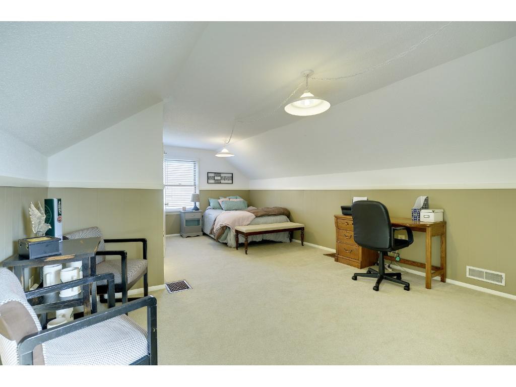 The upstairs master suite is spacious enough to provide an office or sitting area. Attached 1/2 bath is off to the left.