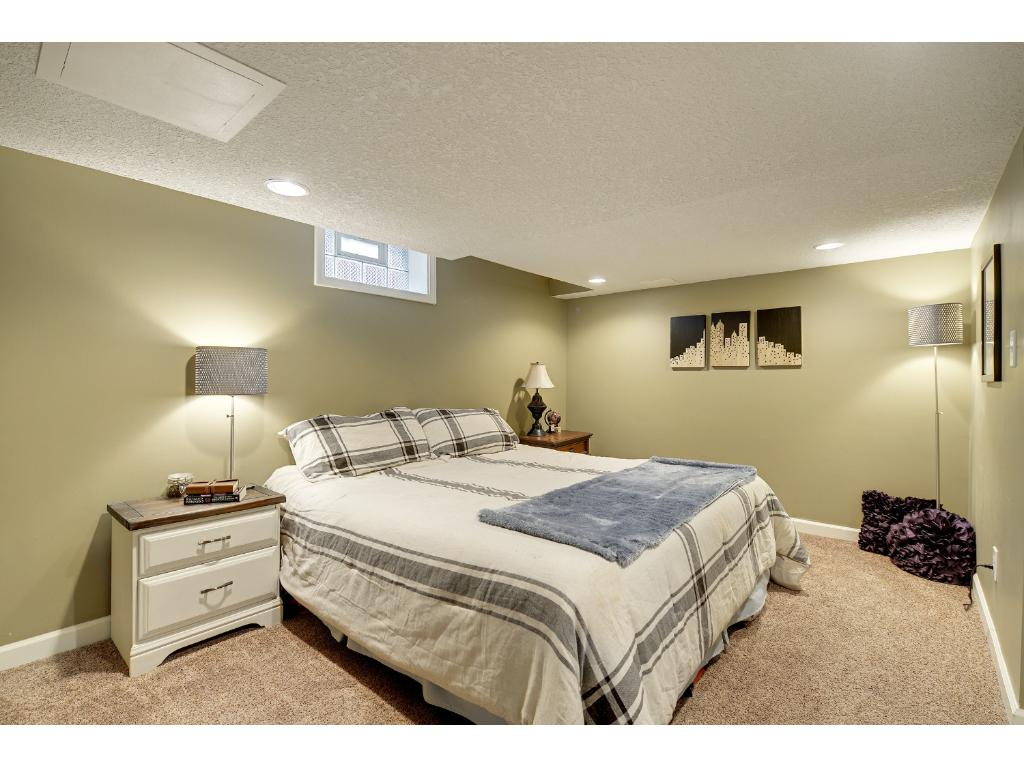 Lower level non-conforming bedroom is perfect for a guest suite, master suite, or office! Two closets including a walk-in.