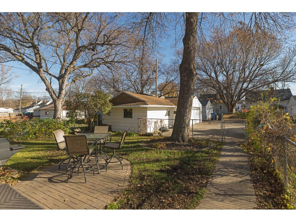 Backyard offers a newer paver patio perfect for grilling and a fully fenced in backyard for your pups!