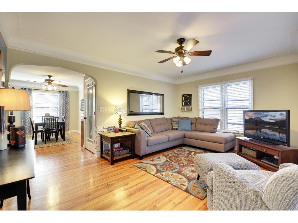 Beautiful coved ceilings and hardwood floors create a warm feeling in the living room.