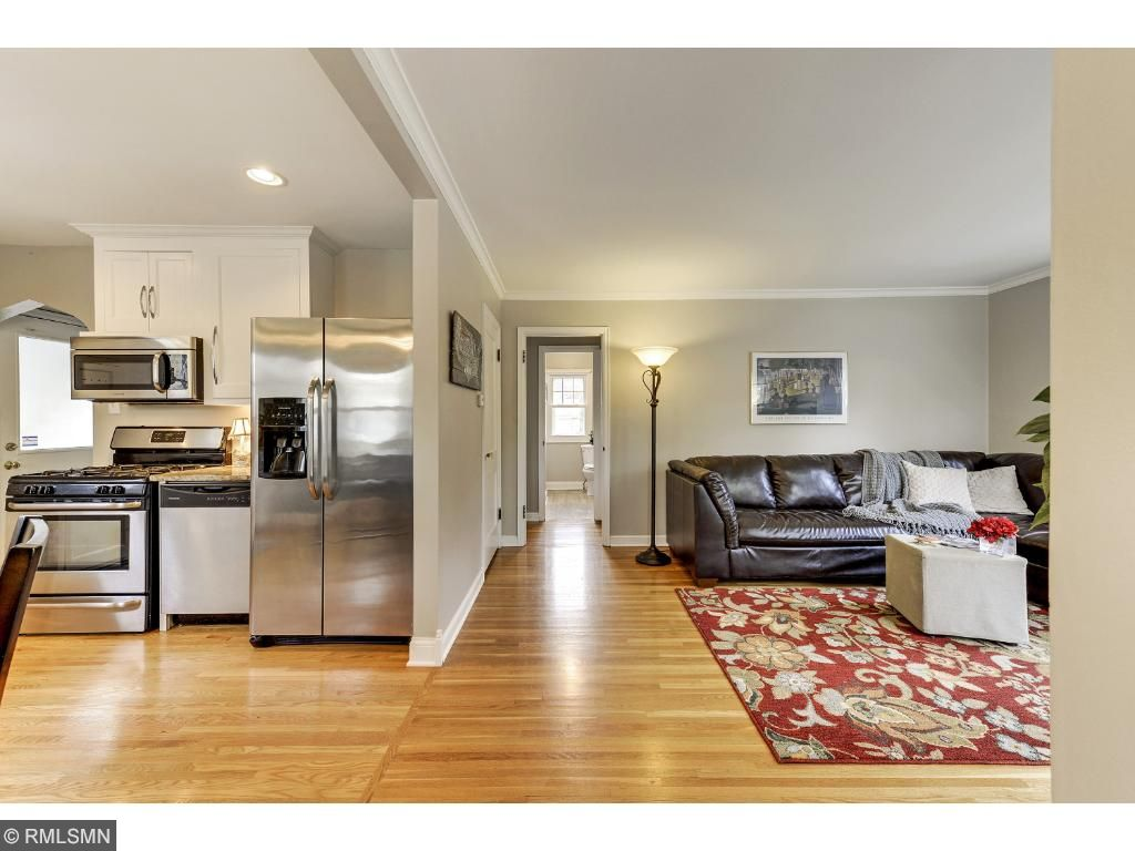 Spacious living room with hard wood floors and freshly painted walls!  Newer windows too!   5525 36th Ave S