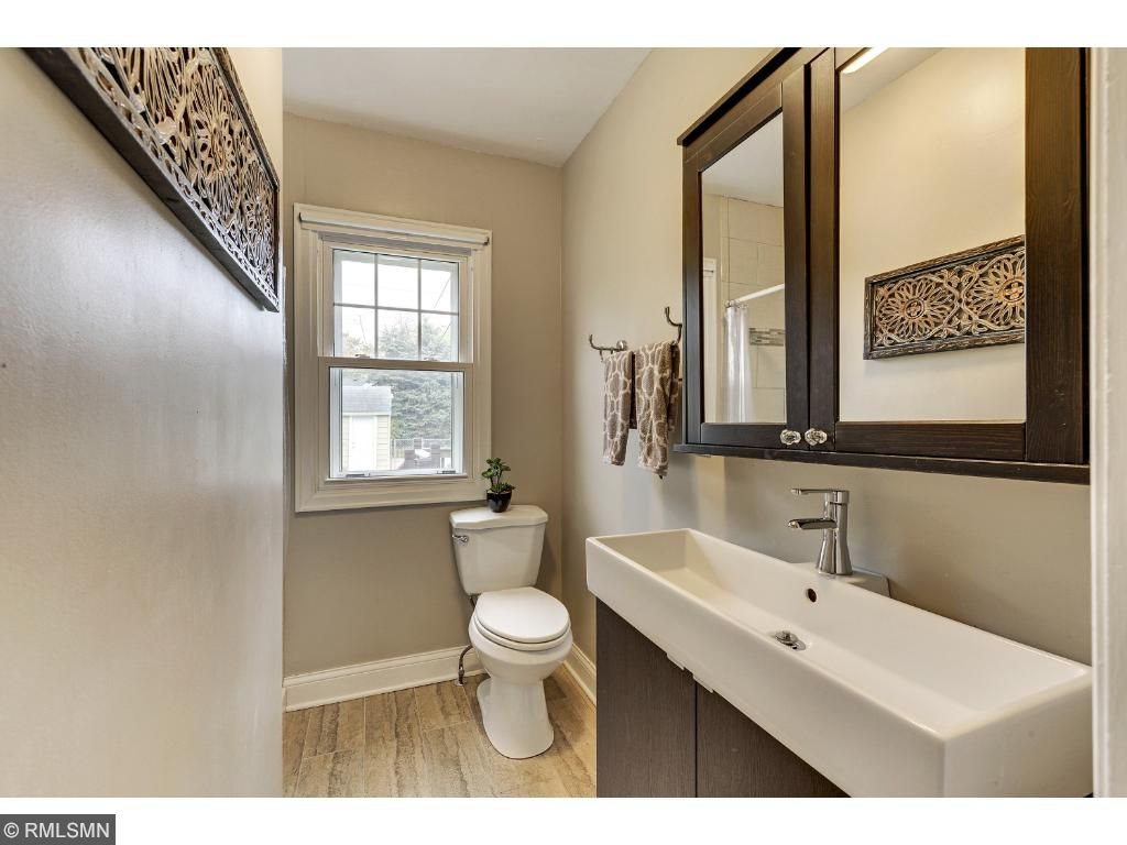 Second main floor bedroom could be an office.  It also provides access to the back yard deck!  5525 36th Ave S