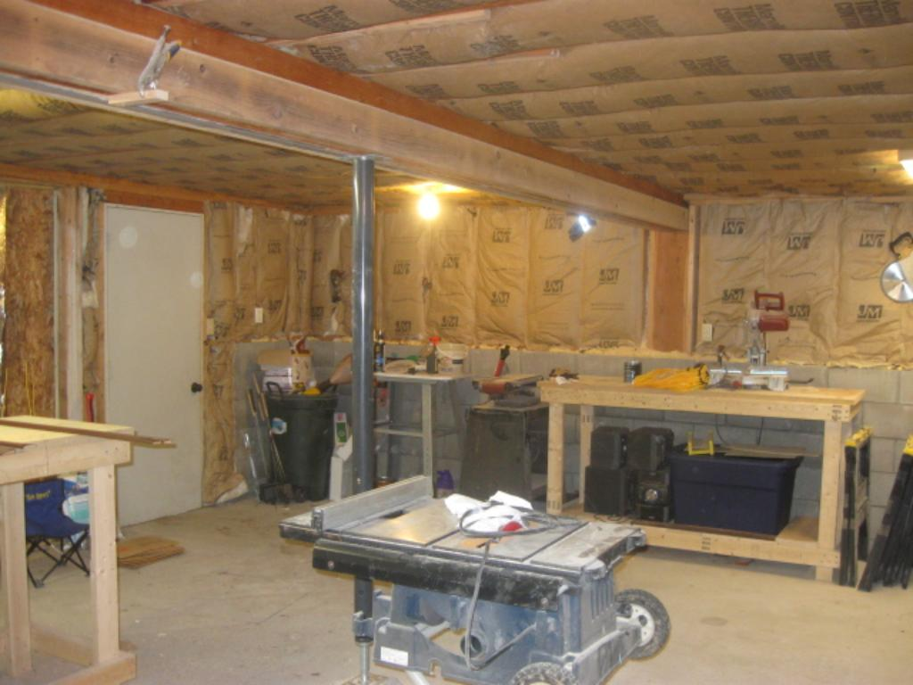 Calling all woodworkers, hobby, and toy loving people.  This is a spectacular 2 car garage is currently being used for a work shop.  It's insulated and heated.  Could be used for storing boats, RV's, motorcycles or your collector car.