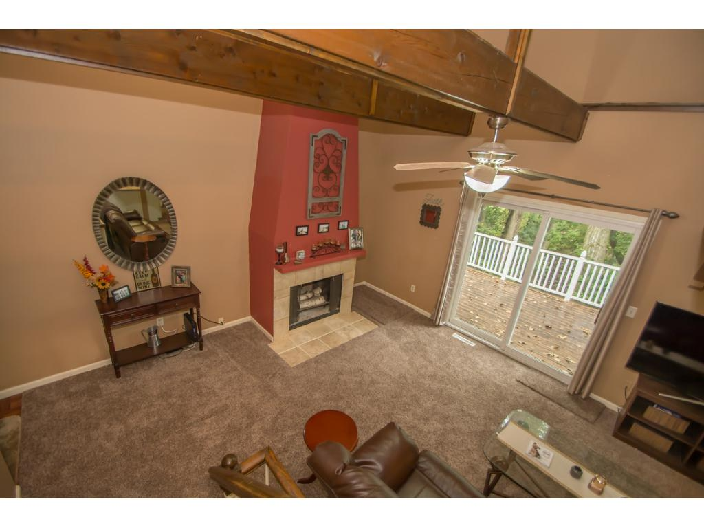 Main floor living area featuring 2-sty vaulted ceiling with beams