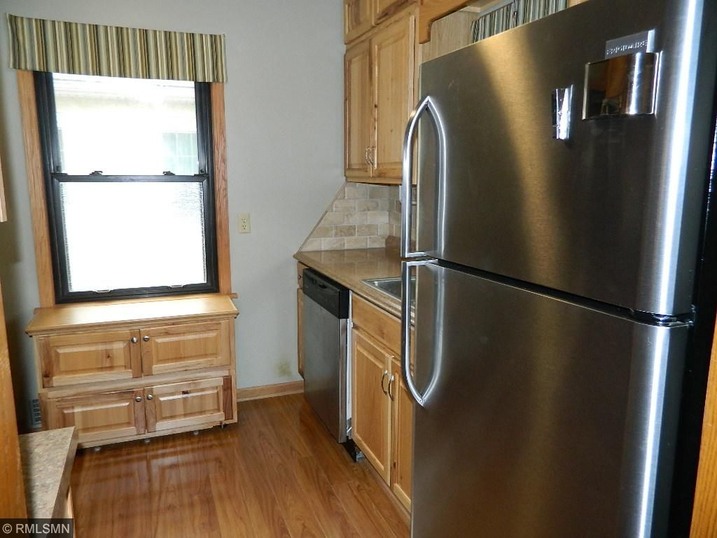 Stainless steel appliances, back splash counters and beautiful Cabinetry