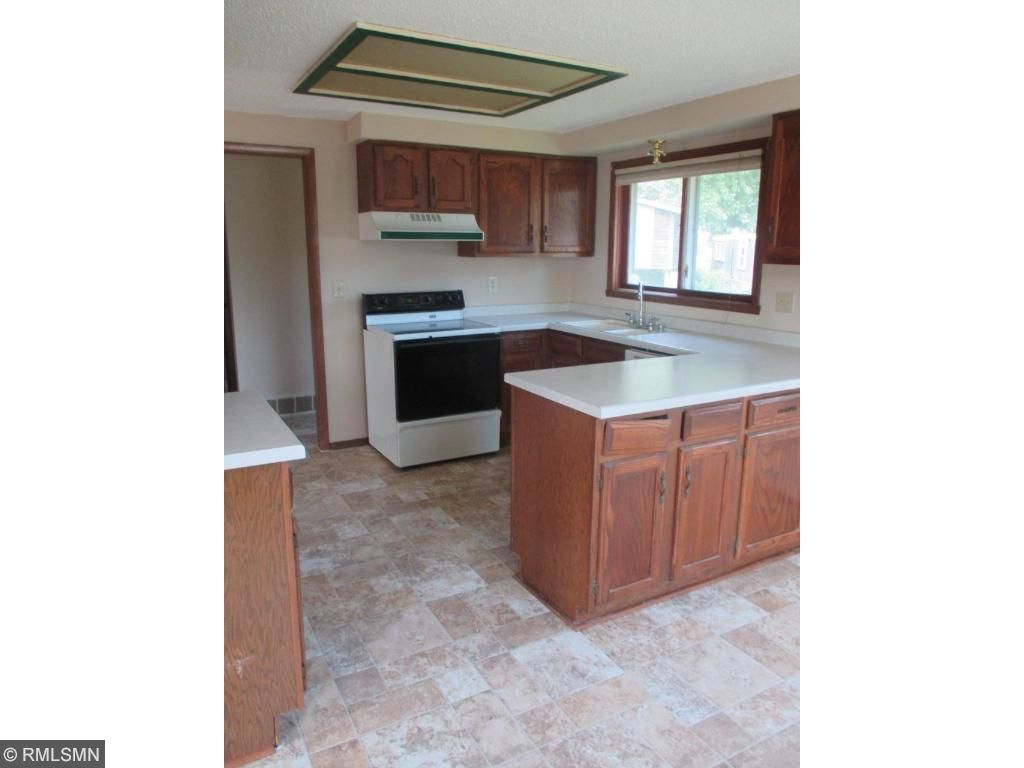 Kitchen is bright and open and has nice large kitchen window.