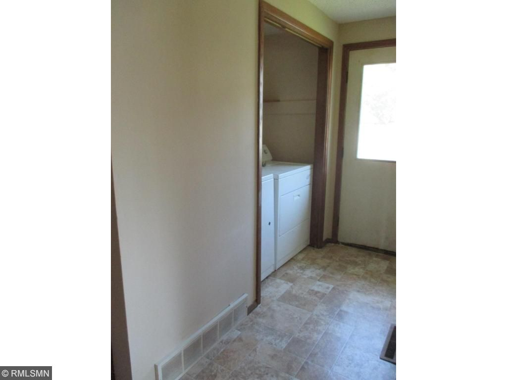 Convenience of a main level laundry.  Door leads to back yard.