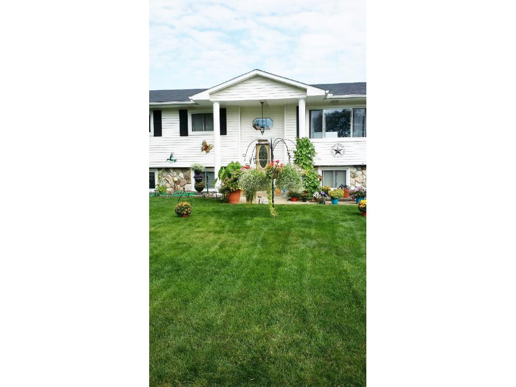 Move in ready home perfect for a family.  Amazing landscaping, flat back yard and extra garage.