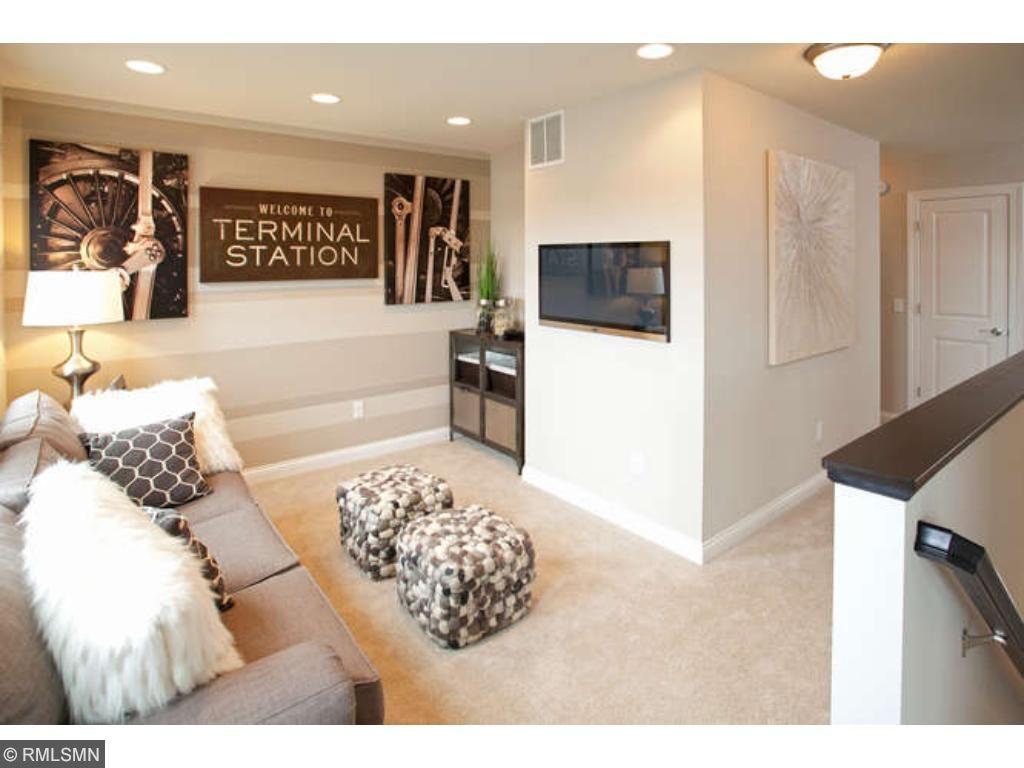 Upper level loft space (photo of model home)