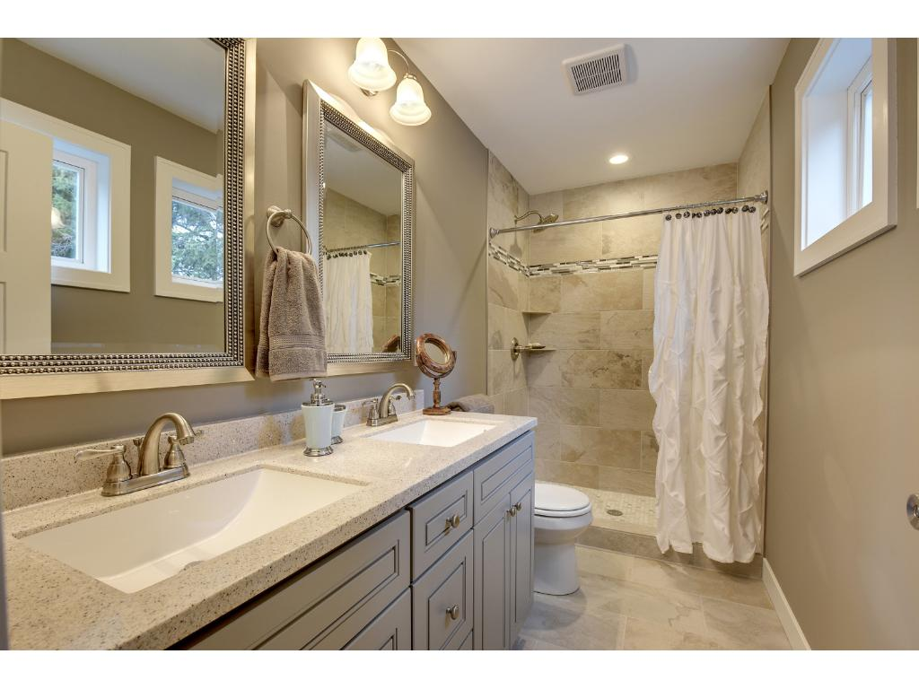 Master Bathroom with painted cabinets and a double vanity. Custom tile shower too.