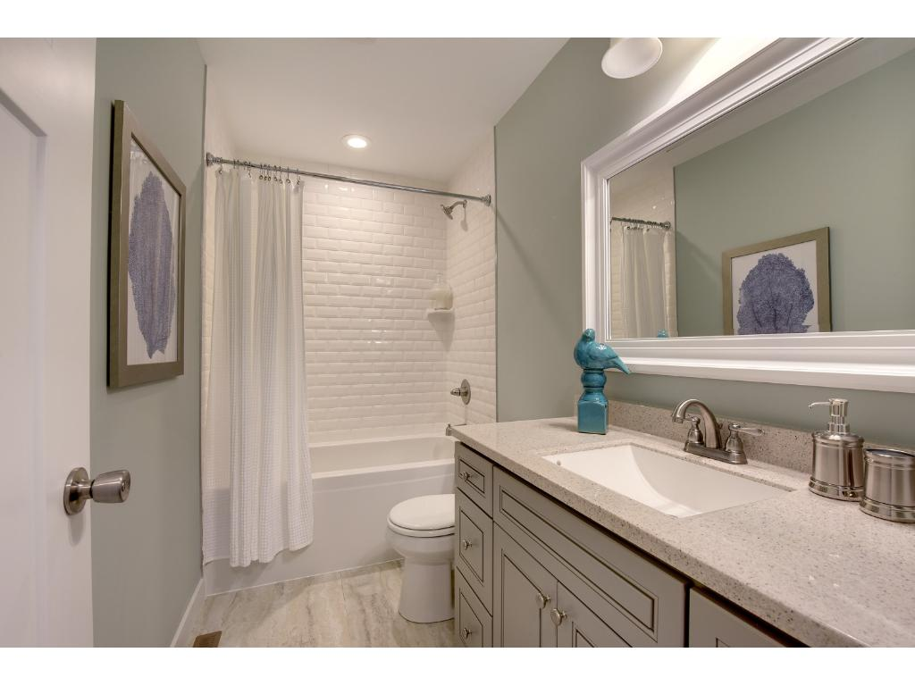 Upper level full Bath features a nice deep tub and beveled tile. Beautiful!