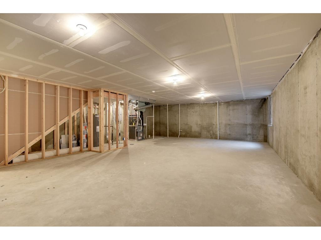 Unfinished basement includes egress window and bathroom rough in! Add & customize the lower level with a new bedroom, bath & family room. A passive radon mitigation system is in place.