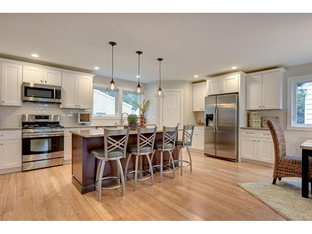 Abundant storage and lots of food prep space in this kitchen.  A  7 foot long granite topped island provides seating for 4, lots of soft- close drawers and cabinets and a great place to prepare meals.