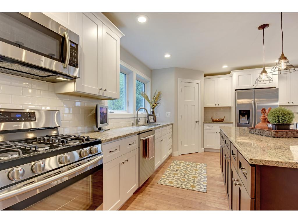 5 burner gas range and a vented microwave. A true cook's kitchen with a walk-in corner pantry.