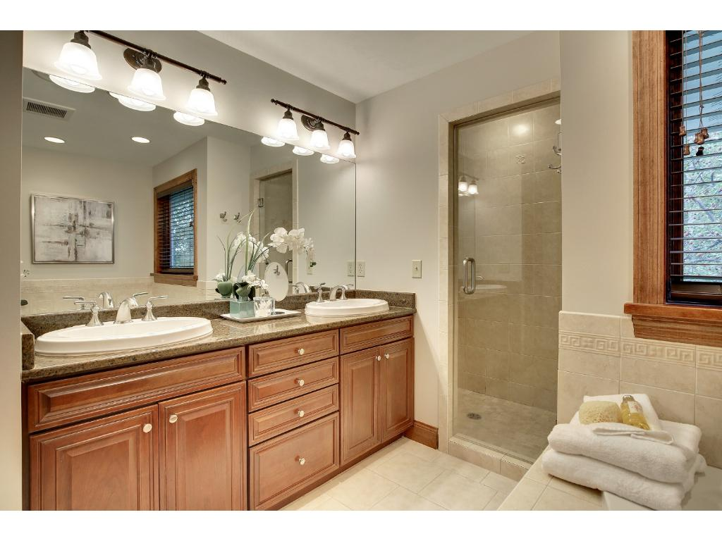 The Master Bath has both a jetted tub, AND a walk-in shower.  Plus double vanities and a private water closet make getting ready a breeze.