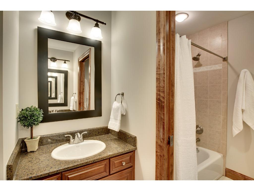 The upper level Bath suite features double vanities and a pocket door to the shower so that everyone can get ready at once!