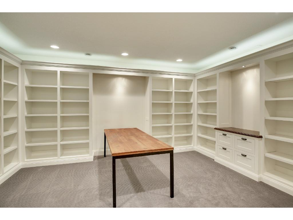 The Office/Library/Trophy Room is just waiting for your touch (or maybe all of your shoes?) to make it yours!