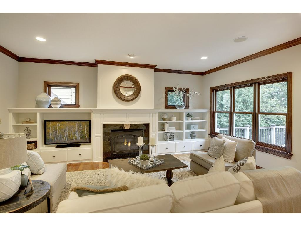 The bright and spacious Family room anchors on  the gas fireplace, offering a cozy retreat, year-round.