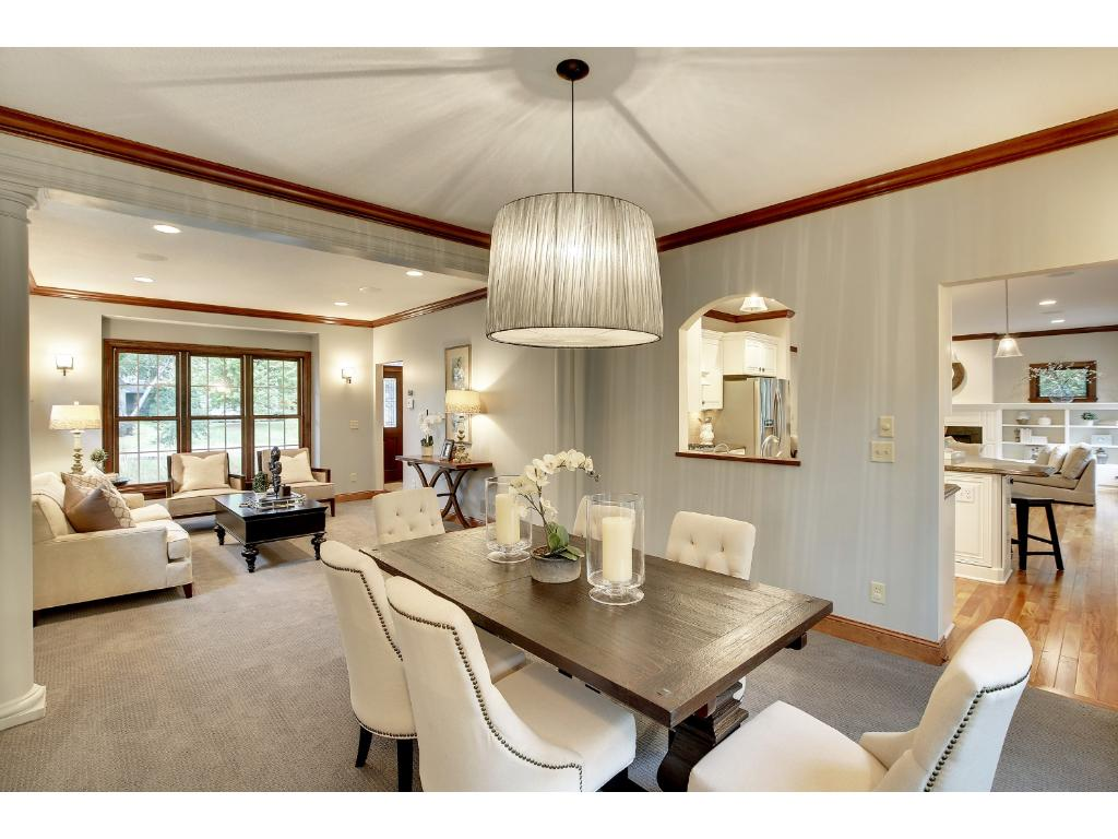 The Formal Dining Room boasts huge windows for views of the back yard, and shared space with the Living Room.