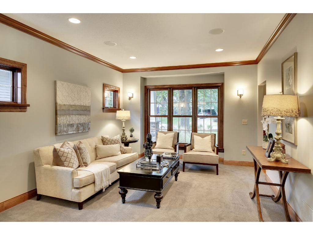 The Living Room has matching large windows and adds yet another perfect spot for entertaining the whole crew.