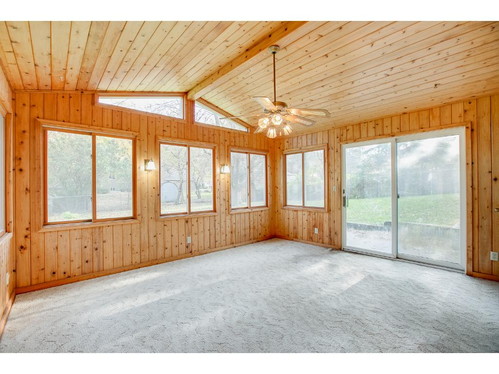 Large 5 BR/ 2 BA home that features a gorgeous 3 season porch off of the family room!